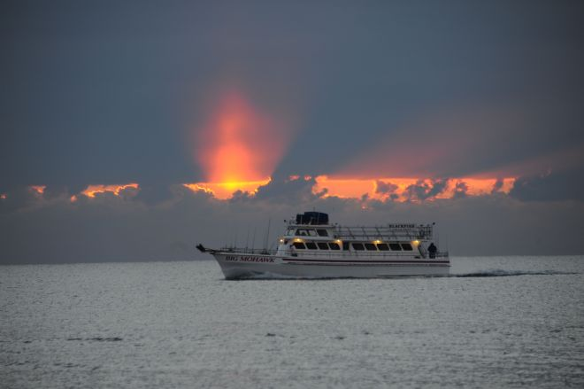 Big Mohawk by Ted Aanensen. This fishing boat was photographed at sunset,  off the beach in Ocean Grove , NJ